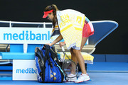 Ana Ivanovic of Serbia walks off the court after play is suspended due to her coach Nigel Sears falling over in the stands in her third round match against Madison Keys of the United States during day six of the 2016 Australian Open at Melbourne Park on January 23, 2016 in Melbourne, Australia.