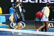 Ana Ivanovic of Serbia and Madison Keys of the United States walk off the court after play is suspended due to Ivanovic's coach Nigel Sears fell over in the stands during their third round match during day six of the 2016 Australian Open at Melbourne Park on January 23, 2016 in Melbourne, Australia.