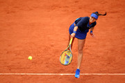 Vitalia Diatchenko of Russia serves during the Ladie's Singles first round match against Lucie Safarova of France on day one of the 2016 French Open at Roland Garros on May 22, 2016 in Paris, France.