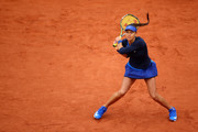 Vitalia Diatchenko of Russia hits a backhand during the Ladie's Singles first round match against Lucie Safarova of France on day one of the 2016 French Open at Roland Garros on May 22, 2016 in Paris, France.