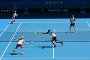 Nick Kyrgios of Australia Green partnered with Daria Gavrilova plays a backhand in the mixed doubles match against Alexander Zverev and Sabine Lisicki of Germany during day one of the 2016 Hopman Cup at Perth Arena on January 3, 2016 in Perth, Australia.