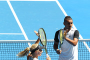 Nick Kyrgios and Daria Gavrilova of Australia Green celebrate defeating Alexander Zverev and Sabine Lisicki of Germany in the mixed doubles game during day one of the 2016 Hopman Cup at Perth Arena on January 3, 2016 in Perth, Australia.