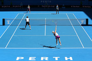 Sabine Lisicki of Germany partnered with Alexander Zverev of Germany serves in the mixed doubles match against Nick Kyrgios and Daria Gavrilova of Australia Green during day one of the 2016 Hopman Cup at Perth Arena on January 3, 2016 in Perth, Australia.
