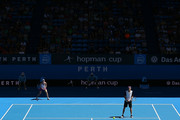 Nick Kyrgios of Australia Green partnered with Daria Gavrilova serves in the mixed doubles match against Alexander Zverev and Sabine Lisicki of Germany during day one of the 2016 Hopman Cup at Perth Arena on January 3, 2016 in Perth, Australia.