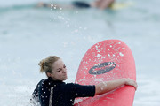 Sabine Lisicki and Alexander Zverev of Germany have a surfing lesson at Trigg beach during day two of the 2016 Hopman Cup at Perth Arena on January 4, 2016 in Perth, Australia.