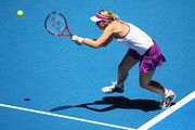 Sabine Lisicki of Germany plays a forehand to Caroline Garcia of France in the womens singles match during day four of the 2016 Hopman Cup at Perth Arena on January 6, 2016 in Perth, Australia.