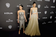 TV personalities Kourtney Kardashian (L) and Kylie Jenner attend InStyle and Warner Bros. 73rd Annual Golden Globe Awards Post-Party at The Beverly Hilton Hotel on January 10, 2016 in Beverly Hills, California.