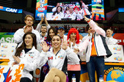 Gabrielle Daleman of Team North America celebrates with team captain Kristi Yamaguchi and teammates after seeing her score following the Ladies Singles Short Program on day 1 of the KOSE Team Challenge at Spokane Arena on April 22, 2016 in Spokane, Washington.