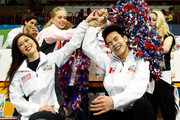 Nam Nguyen of Team North America celebrates with team captain Kristi Yamaguchi and teammates after seeing his score following the Men's Singles Short Program on day 1 of the KOSE Team Challenge at Spokane Arena on April 22, 2016 in Spokane, Washington.