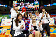 Gracie Gold of Team North America celebrates with team captain Kristi Yamaguchi and teammates after seeing her score following the Ladies Singles Short Program on day 1 of the KOSE Team Challenge at Spokane Arena on April 22, 2016 in Spokane, Washington.