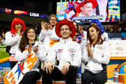 Adam Rippon of Team North America celebrates with team captain Kristi Yamaguchi and teammates after seeing his score following the Men's Singles Short Program on day 1 of the KOSE Team Challenge at Spokane Arena on April 22, 2016 in Spokane, Washington.