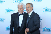 """Former Prime Minister Tony Blair and Bill Austin pose on the red carpet at the 2016 Starkey Hearing Foundation """"So the World May Hear"""" awards gala at the St Paul RiverCentre on July 17, 2016 in St Paul, Minnesota."""
