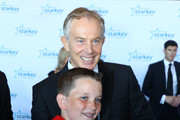 """Former Prime Minister Tony Blair talks to a student journalist on the red carpet at the 2016 Starkey Hearing Foundation """"So the World May Hear"""" awards gala at the St Paul RiverCentre on July 17, 2016 in St Paul, Minnesota."""