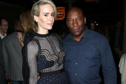 Actress Sarah Paulson (L) and filmmaker John Singleton attend the 32nd annual Television Critics Association Awards during the 2016 Television Critics Association Summer Tour at The Beverly Hilton Hotel on August 6, 2016 in Beverly Hills, California.