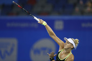 Sabine Lisicki of Germany serves against Ekaterina Makarova of Russia in a match against during Day 1 of the 2016 Wuhan Open at Optics Valley International Tennis Center on September 25, 2016 in Wuhan, China.