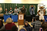 Jabari Parker #12 of the Milwaukee Bucks and Bucks legend Michael Redd, along with mascot Bango interact with local families and assist volunteers with the distribution of Thanksgiving dinner baskets on November 21, 2017 at the House of Peace in Milwaukee, Wisconsin. NOTE TO USER:  User expressly acknowledges and agrees that, by downloading and or using this Photograph, user is consenting to the terms and conditions of the Getty Images License Agreement.  Mandatory Copyright Notice:  Copyright 2017 NBAE