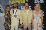 Brittney Marie Cole, Brian Kelley and Tyler Hubbard of Florida Georgia Line, and Hayley Hubbard attend the 2017 CMT Music awards at the Music City Center on June 7, 2017 in Nashville, Tennessee.