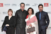 Actor Irrfan Khan (R) and guests attends the Opening Night Gala of the 14th annual Dubai International Film Festival held at the Madinat Jumeriah Complex on December 6, 2017 in Dubai, United Arab Emirates.