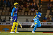 In this handout image provided by CPL T20, Kyle Mayers (R) of St Lucia Stars celebrate the dismissal of Shoaib Malik (L) of the Barbados Tridents during Match 8 of the 2017 Hero Caribbean Premier League between St Lucia Stars v Barbados Tridents at the Darren Sammy  Stadium on August 10, 2017 in Gros Islet, Saint Lucia.