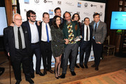"""Director Luca Guadagnino poses with the cast of """"Call Me By Your Name"""" with their award for Best Feature Film at The 2017 IFP Gotham Independent Film Awards co-sponsored by Landmark Vineyards at Cipriani Wall Street on November 27, 2017 in New York City."""