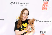 """LAFF Director Jennifer Cochis (L) and Arwen the Dog attend """"The Movie Crypt"""" Podcast during 2017 Los Angeles Film Festival at Arclight Cinemas Culver City on June 18, 2017 in Culver City, California."""