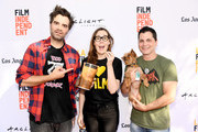 """(L-R) Joe Lynch, LAFF Director Jennifer Cochis, Arwen the Dog, and Adam Green attend """"The Movie Crypt"""" Podcast during 2017 Los Angeles Film Festival at Arclight Cinemas Culver City on June 18, 2017 in Culver City, California."""