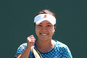 Kurumi Nara of Japan celebrates match point  against Francesca Schiavone of Italy after defeating her during Day 2 of the Miami Open at Crandon Park Tennis Center on March 21, 2017 in Key Biscayne, Florida.
