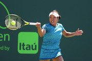 Kurumi Nara of Japan plays a forehand  against Francesca Schiavone of Italy after defeating her during Day 2 of the Miami Open at Crandon Park Tennis Center on March 21, 2017 in Key Biscayne, Florida.