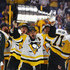 Chris Kunitz #14 of the Pittsburgh Penguins celebrates with the Stanley Cup Trophy after they defeated the Nashville Predators 2-0 to win the 2017 NHL Stanley Cup Final at the Bridgestone Arena on June 11, 2017 in Nashville, Tennessee.