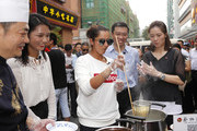 Sania Mirza of India makes noodles with Li Na of China looks on at an old city area of Wuhan during Day 2 of 2017 Wuhan Open on September 25, 2017 in Wuhan, China.