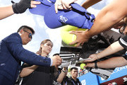 Li Na of China autographs for students after a tennis clinic which is part of the Wuhan Open Project at 2017 Wuhan Open on September 28, 2017 in Wuhan, China.