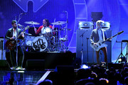 (L-R) Caleb Followill, Nathan Followill and Jared Followill of Kings of Leon perform onstage during the 2017 iHeartRadio Music Festival at T-Mobile Arena on September 23, 2017 in Las Vegas, Nevada.