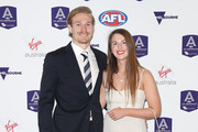 Tom Stewart of the Cats and partner Hannah Davis arrive during the 2018 AFL All-Australia Awards at the Palais Theatre on August 29, 2018 in Melbourne, Australia.