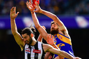 Brodie Grundy of the Magpies competes for a mark with Josh Kennedy of the Eagles during the 2018 Toyota AFL Grand Final match between the West Coast Eagles and the Collingwood Magpies at the Melbourne Cricket Ground on September 29, 2018 in Melbourne, Australia.