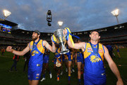 Josh Kennedy and Shannon Hurn of the Eagles  hold up the Premiership Trophy after the Eagles won the 2018 AFL Grand Final match between the Collingwood Magpies and the West Coast Eagles at Melbourne Cricket Ground on September 29, 2018 in Melbourne, Australia.