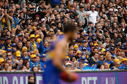 Fans look on as Josh Kennedy of the Eagles lines up for goal during the 2018 AFL Grand Final match between the Collingwood Magpies and the West Coast Eagles at Melbourne Cricket Ground on September 29, 2018 in Melbourne, Australia.
