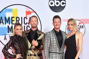 (L-R) Brittney Marie Cole, Brian Kelley and Tyler Hubbard Florida Georgia Line, and Hayley Stommel attend the 2018 American Music Awards at Microsoft Theater on October 9, 2018 in Los Angeles, California.