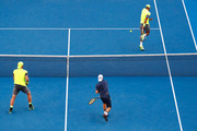 Sam Groth (L) of Australia and Lleyton Hewitt of Australia compete in their quarter-final match against Juan Sebastian Cabal of Colombia and Robert Farah of Colombia on day 10 of the 2018 Australian Open at Melbourne Park on January 24, 2018 in Melbourne, Australia.