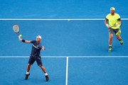 Sam Groth of Australia and Lleyton Hewitt of Australia in their quarterfinals doubles match against Juan Sebastian Cabal and Robert Farah of Colombia on day 10 of the 2018 Australian Open at Melbourne Park on January 24, 2018 in Melbourne, Australia.