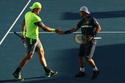 Sam Groth (L) of Australia and Lleyton Hewitt of Australia compete in their first round men's doubles match against Denis Istomin of Uzbekistan and Mikhail Kukushkin of Kazakhstan on day four of the 2018 Australian Open at Melbourne Park on January 18, 2018 in Melbourne, Australia.