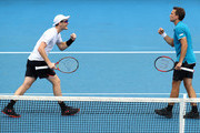 Jamie Murray of Great Britain and Bruno Soares of Brazil talk tactics in their second round men's doubles match against Leander Paes of India and Purav Raja of India on day six of the 2018 Australian Open at Melbourne Park on January 20, 2018 in Melbourne, Australia.