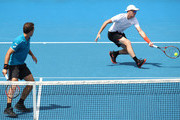Bruno Soares of Brazil (L) and Jamie Murray of Great Britain compete in their second round men's doubles match against Leander Paes of India and Purav Raja of India on day six of the 2018 Australian Open at Melbourne Park on January 20, 2018 in Melbourne, Australia.