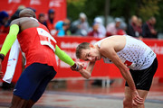 Mo Farah of Great Britain, left, congratulates Galen Rupp after Farah won the 2018 Bank of America Chicago Marathon on October 7, 2018 in Chicago, Illinois.