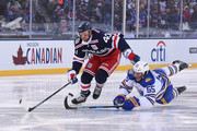 Rasmus Ristolainen #55 of the Buffalo Sabres dives for the poke check as Michael Grabner #40 of the New York Rangers plays the puck past Ristolainen in the second period of the 2018 Bridgestone NHL Winter Classic between the New York Rangers and the Buffalo Sabres at Citi Field on January 1, 2018 in the Flushing neighborhood of the Queens borough of New York City.