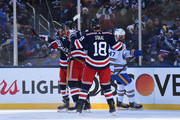 Michael Grabner #40 of the New York Rangers celebrates his goal with Brady Skjei #76 and Marc Staal #18 as Zach Bogosian #47 of the Buffalo Sabres looks on during the first period of the 2018 Bridgestone NHL Winter Classic between the New York Rangers and the Buffalo Sabres at Citi Field on January 1, 2018 in the Flushing neighborhood of the Queens borough of New York City.