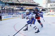 Kyle Okposo #21 of the Buffalo Sabres moves around J.T. Miller #10 of the New York Rangers during the 2018 Bridgestone NHL Winter Classic at Citi Field on January 1, 2018 in the Flushing neighborhood of the Queens borough of New York City. The Rangers defeated the Sabres 3-2 in overtime.