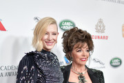 Cate Blanchett (L) and Dame Joan Collins attend the 2018 British Academy Britannia Awards presented by Jaguar Land Rover and American Airlines at The Beverly Hilton Hotel on October 26, 2018 in Beverly Hills, California.