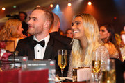 Tom Mitchell of the Hawks and partner Hannah Davis look on during the 2018 Brownlow Medal Count at Crown Palladium on September 24, 2018 in Melbourne, Australia.