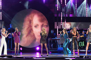 (L-R)  Maddie Marlow and Tae Dye of musical duo Maddie and Tae, Carrie Underwood, Hannah Mulholland, Naomi Cooke and Jennifer Wayne of musical group Runaway June perform onstage during the 2018 CMT Artists of The Year at Schermerhorn Symphony Center on October 17, 2018 in Nashville, Tennessee.