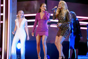 (L-R) Maddie Marlow and Tae Dye of musical duo Maddie and Tae and Carrie Underwood perform onstage during the 2018 CMT Artists of The Year at Schermerhorn Symphony Center on October 17, 2018 in Nashville, Tennessee.